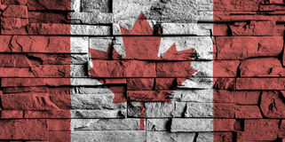 Canada flag painting on high detail of old brick wall . 3D illustration Stock Photos