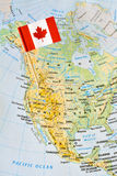 Canada flag pin on map royalty free stock images
