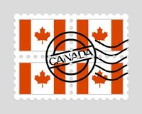 Canada flag on postage stamps. Canadian flag on postage stamps Royalty Free Stock Photography