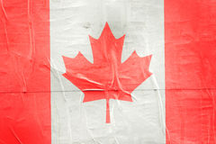 Canada Flag Print on Grunge Poster Paper Stock Photography
