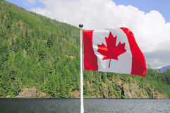 Canada flag on the ship. stock image