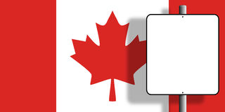 Canada Flag Sign. Flag of Canada under a blank sign nailed to a post Royalty Free Stock Photos