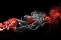Canada flag smoke. Isolated on a black background Stock Photography