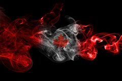 Canada flag smoke. Isolated on a black background Stock Images