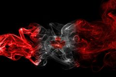 Canada flag smoke. Isolated on a black background Royalty Free Stock Images