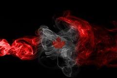 Canada flag smoke. Isolated on a black background Royalty Free Stock Photo