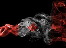 Canada flag smoke. Isolated on a black background Royalty Free Stock Image