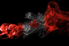 Canada flag smoke. Isolated on a black background Royalty Free Stock Photography