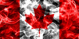 Canada flag smoke isolated on a black background. Canada smoke flag isolated on a black background Royalty Free Stock Image