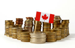 Canada flag with stack of money coins Royalty Free Stock Images