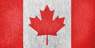 Canada flag texture relief. Texture of Canada flag on the wall of relief plaster stock photos