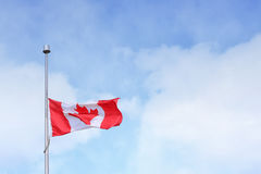 Canada Flag Under Blue and White Sky at Daytime Stock Image