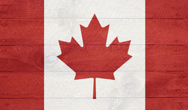 Canada flag on wood boards with nails Royalty Free Stock Images