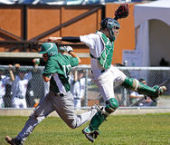 Canada games baseball men catcher runner Royalty Free Stock Photography