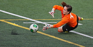 Canada games soccer women keeper ball save. Women's soccer keeper Nicole McInnis of Prince Edward Island makes a save at the Canada Games August 7, 2013 in stock images