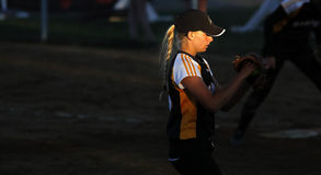 Canada games softball woman pitcher sun spotlight Royalty Free Stock Photo