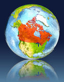 Canada on globe with reflection. Illustration with detailed planet surface. Elements of this image furnished by NASA Royalty Free Stock Image