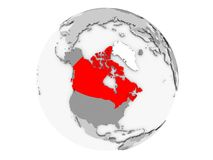 Canada on grey globe isolated. Canada highlighted in red on grey political globe. 3D illustration isolated on white background Stock Images