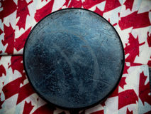 Canada hockey puck. On hockey stick tape Royalty Free Stock Image
