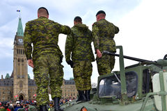 Canada honours veterans who served in Afghanistan. Soldiers who served in the Canadian Forces in Afghanistan give salutes while being honored on Parliament Hill royalty free stock image