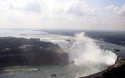 Canada Horseshoe Falls & boats. Niagara Falls, Canada showing the Horseshoe Falls, and Maids of the Mist boats crowded with tourists about to pass Royalty Free Stock Photography