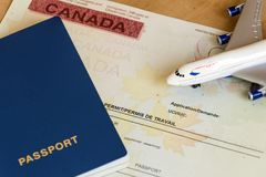 Canadian work permit paper document and passport top view. stock image