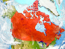 Canada on map with clouds. Canada in red on map with detailed landmass texture, realistic watery oceans and clouds above the surface. 3D illustration. Elements Royalty Free Stock Photography