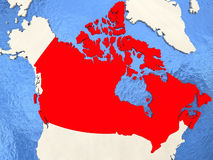 Canada on map. Canada in red on political map with watery oceans. 3D illustration Royalty Free Stock Image