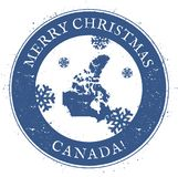 Canada map. Vintage Merry Christmas Canada Stamp. Stylised rubber stamp with county map and Merry Christmas text, vector illustration Royalty Free Stock Photography