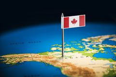 Canada marked with a flag on the map.  royalty free stock images