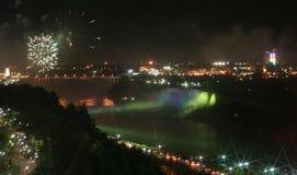 Canada Niagara Falls at night. Niagara Falls, Canada a view of American Falls fireworks and green Illuminations Royalty Free Stock Image
