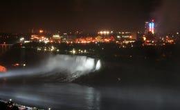 Canada Niagara Falls at night. Niagara Falls, Canada a view of American Falls fireworks with pure white Illuminations and light beam Stock Photo