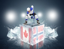 Canada-Norway game. Face-off player on the ice cube. Royalty Free Stock Photo