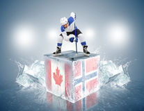 Canada-Norway Game.  Face-off player on the ice cube Stock Photo