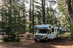 Canada Algonquin National Park 30.09.2017 Parked RV camper Lake two rivers Campground Beautiful natural forest landscape Royalty Free Stock Images