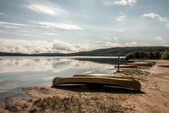Canada Ontario Lake of two rivers Canoe Canoes parked on beach near water in Algonquin National Park. Canada Ontario Lake of two rivers Canoe Canoes parked on Royalty Free Stock Images