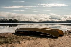 Canada Ontario Lake of two rivers Canoe Canoes parked on beach near water in Algonquin National Park. Canada Ontario Lake of two rivers Canoe Canoes parked on Royalty Free Stock Image