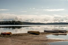 Canada Ontario Lake of two rivers Canoe Canoes parked on beach near water in Algonquin National Park. Canada Ontario Lake of two rivers Canoe Canoes parked on Royalty Free Stock Photo