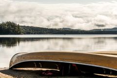 Canada Ontario Lake of two rivers Canoe Canoes parked on beach near water in Algonquin National Park. Canada Ontario Lake of two rivers Canoe Canoes parked on Stock Photo
