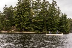 Canada Ontario Lake of two rivers Couple on a Canoe Canoes on the water Algonquin National Park Royalty Free Stock Image