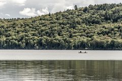 Canada Ontario Lake of two rivers Couple on a Canoe Canoes on the water Algonquin National Park. Canada Ontario Lake of two rivers Couple on a Canoe Canoes on Royalty Free Stock Photos