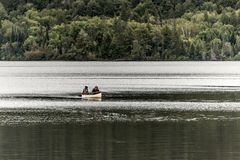 Canada Ontario Lake of two rivers Couple on a Canoe Canoes on the water Algonquin National Park Royalty Free Stock Images