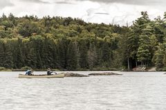 Canada Ontario Lake of two rivers Couple on a Canoe Canoes on the water Algonquin National Park Stock Photos
