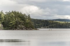 Canada Ontario Lake of two rivers Couple on a Canoe Canoes on the water Algonquin National Park. Canada Ontario Lake of two rivers Couple on a Canoe Canoes on Royalty Free Stock Photography