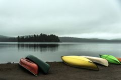 Canada Ontario Lake two rivers grey morning dark atmosphere Canoe Canoes parked beach water in Algonquin National Park stock photography