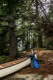 Canada Ontario Lake of two rivers white blank Canoe Canoes parked on island in Algonquin National Park. Canada Ontario Lake two rivers white blank Canoe Canoes Royalty Free Stock Photos