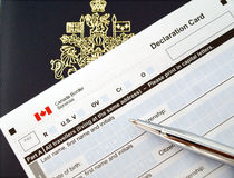 Canada passport on declaration card stock photos