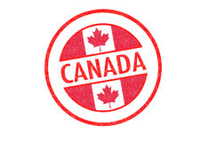 CANADA. Passport-style CANADA rubber stamp over a white background Stock Photos
