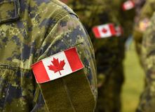 Canada patch flags on soldiers arm. Canadian troops.  royalty free stock photo