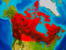 Canada on physical map. Canada highlighted in red on physical map. 3D illustration. Elements of this image furnished by NASA Stock Images